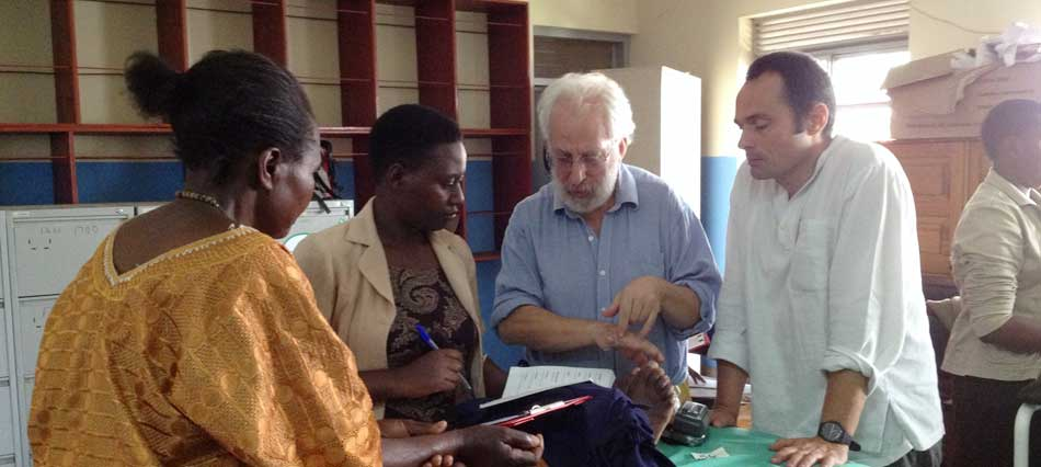 Walter with Richard Mandell in his Pan African Acupuncture Clinic in Uganda